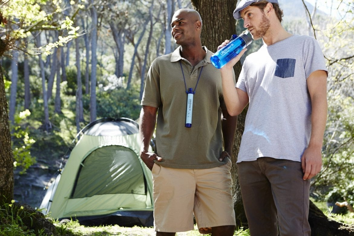 Guys hanging out with LifeStraw Personal and Lifestraw GO
