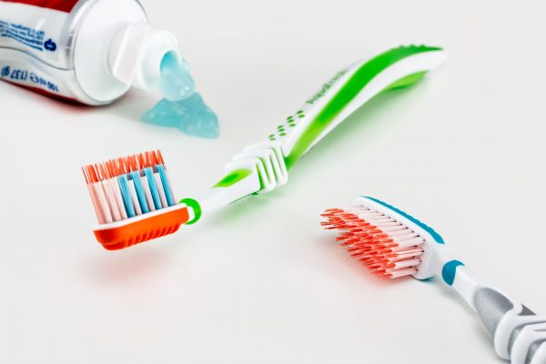 Tooth brushes and toothpaste