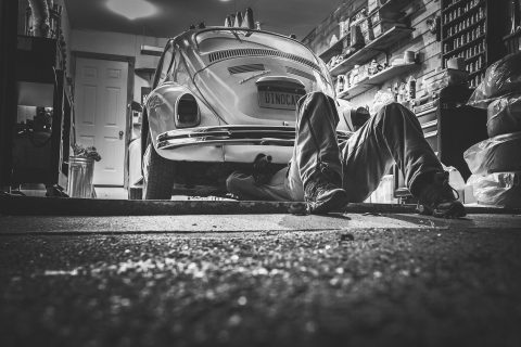 Man fixing vehicle