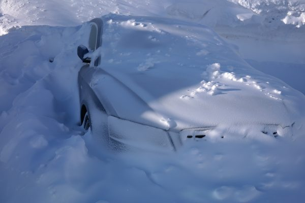 A vehicle buried in deep snow