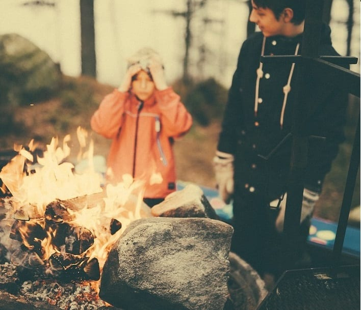 Kid's camping around a fire