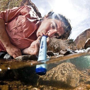 LifeStraw Personal Water Filter being used in a creek.